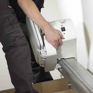 engineer repairing stairlift