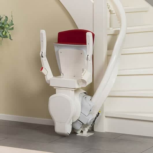 Curved stairlift red seat folded
