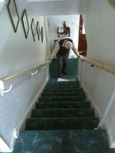 Man struggling on stairs